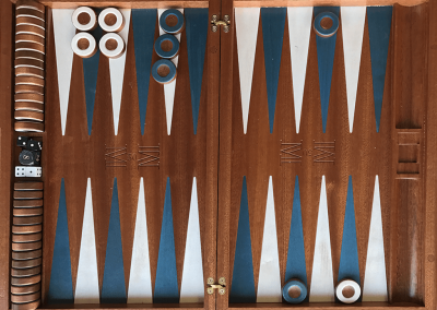 African mahogany with blue and white veneer points and chips