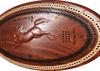 Bloodwood with maple, carved relief center
