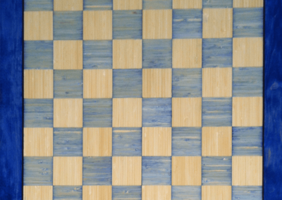 Custom Chess/Checkers board in bamboo with blue dyed alt squares and dark blue dyed border.