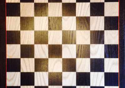 Custom Chess/Checkers board in Oak and Cambia Oak with Bloodwood accent.