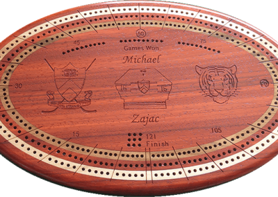 Padauk with maple and cherry, engraved center