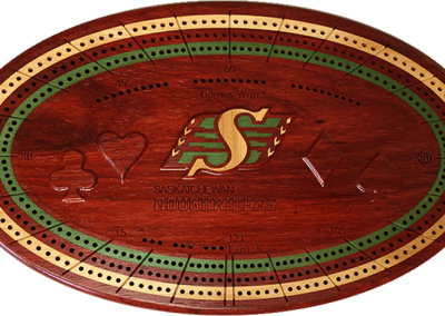 Padauk with veneer inlays and carved personalization