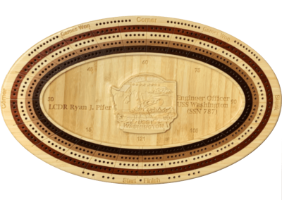 Custom bamboo cribbage board with naval badge carved in center