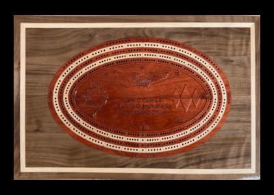 Custom wood crib board inlaid into backgammon board top
