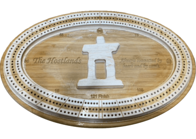 Custo bamboo cribbage board with raised tracks and statue in the center